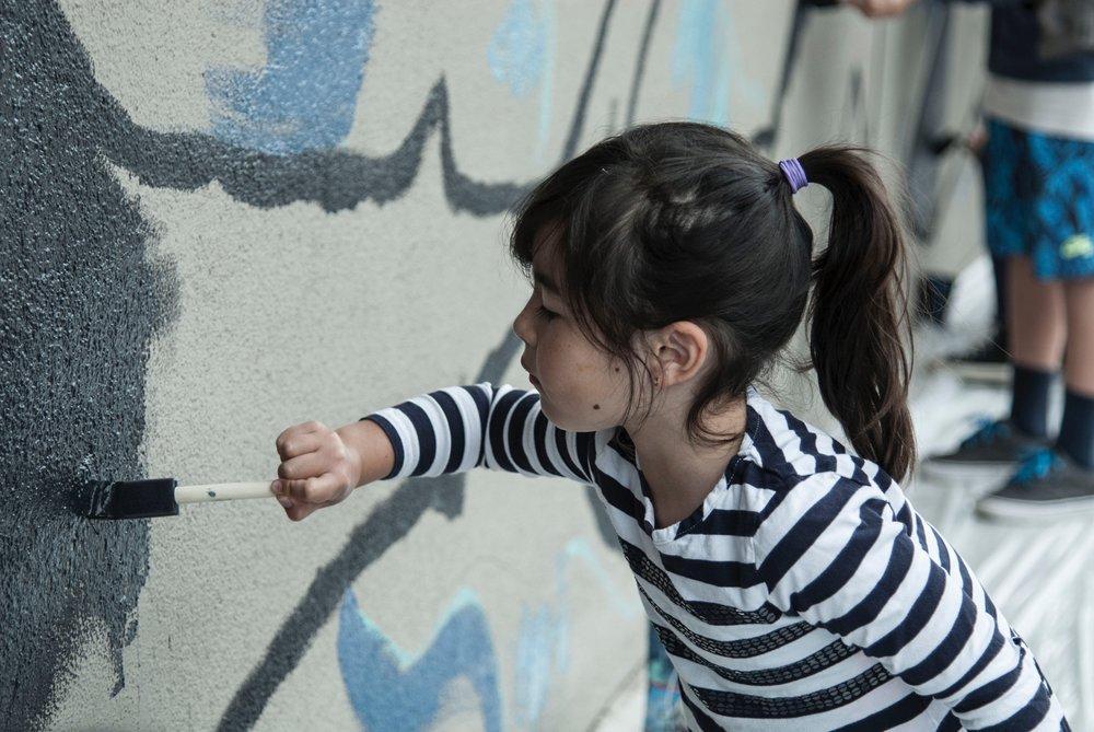 Kids painting the shark mural 3