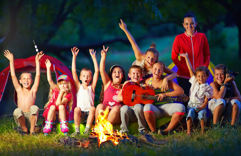 A-Group-of-Happy-Children-in-a-Camp-Fire_28301835_m.jpg