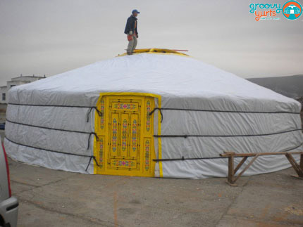 """10-WALLS""-36'YURT - $23,500Complete with high quality felt insulation and hand painted wood structure, decorated water resistant canvas, all necessary ropes and linings, a double window door frame, a vinyl covering on half of the tonoo (top window)diameter: 36 feet (11m)walls height: 6 1/2 feet 1(1.9m)height in center: 11 feet (3.3m)dimensions might vary slightly"