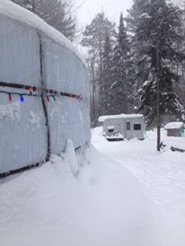The snow piled up around the base of the yurt provided greater insulation and helped keep the platform warm under out feet.  Notice our Sauna in the background?