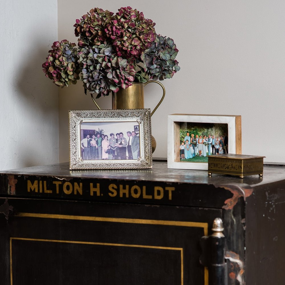 Found in the show room of Sholdt Jewelry in Seattle, is owner, Kalee's grandpa's safe with a family photo from the 80s as well as a current family photo of Kalee's wedding. Showing that this is a family business, and they care about family and relationships. When you buy from Sholdt, you get a jeweler for life, not just a pretty ring.