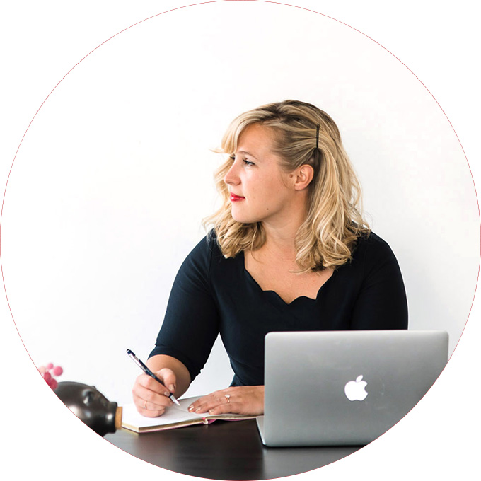 Entrepreneur and woman in business in a black dress at her desk for a business branding shoot with Seattle branding photographer Rebecca Ellison.