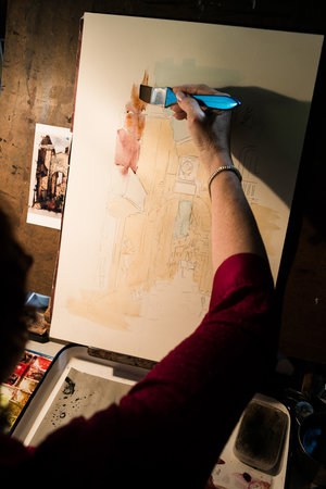 behind the scenes photos of a painter for their website. Top 5 types of images you should have on your website.