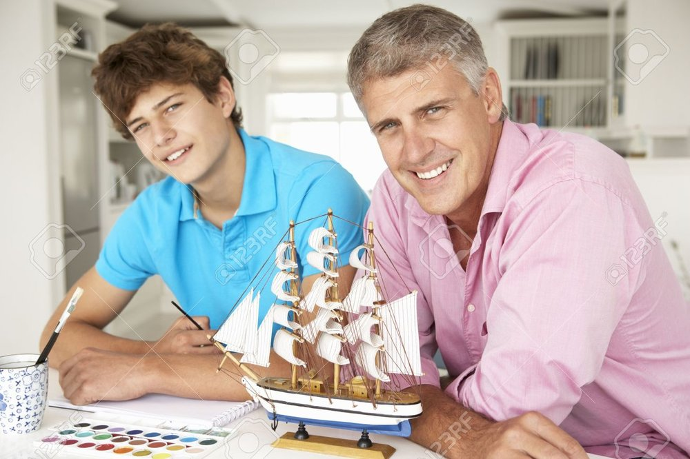 11190546-father-and-teenage-son-model-making-and-painting-stock-photo.jpg