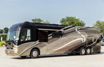 Country Coach_Magna_Previously Owned_Black and Tan_2006_Diesel.jpg