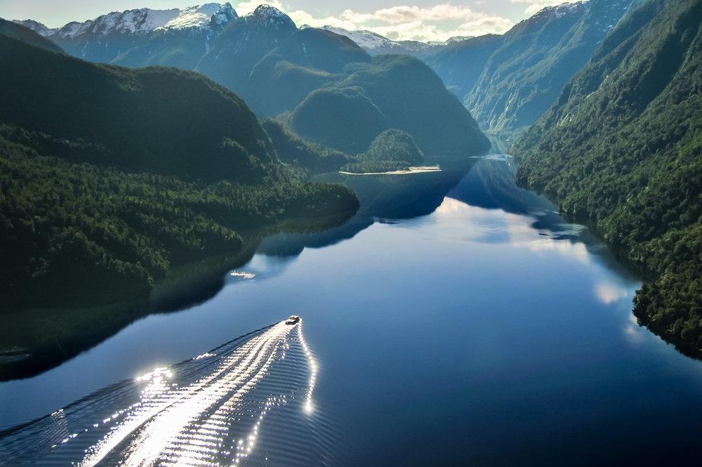 boat cruising up Doubtful Sound Fiordland New Zealand