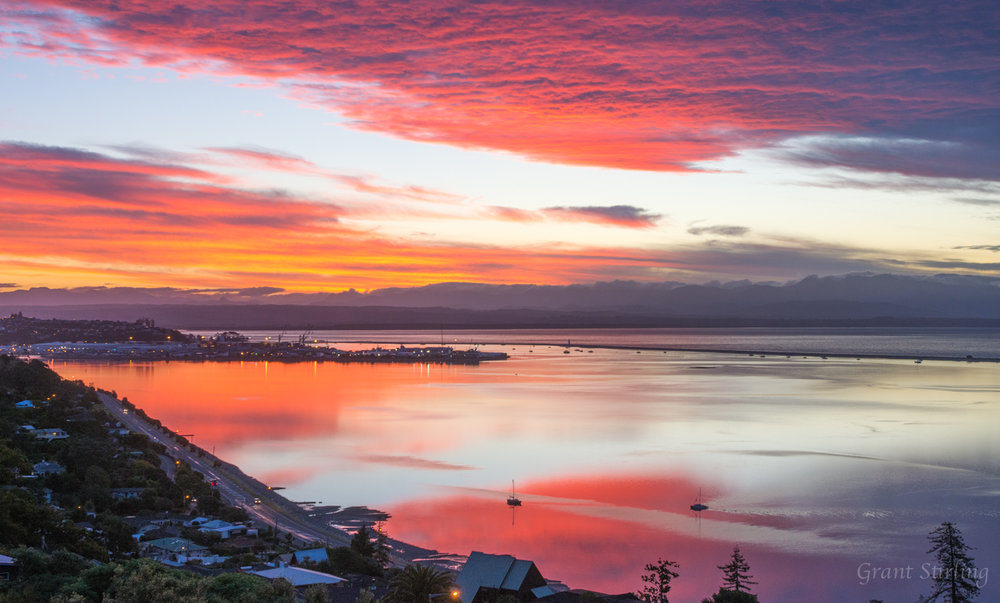 Red sky reflection on Nelson Haven NZ