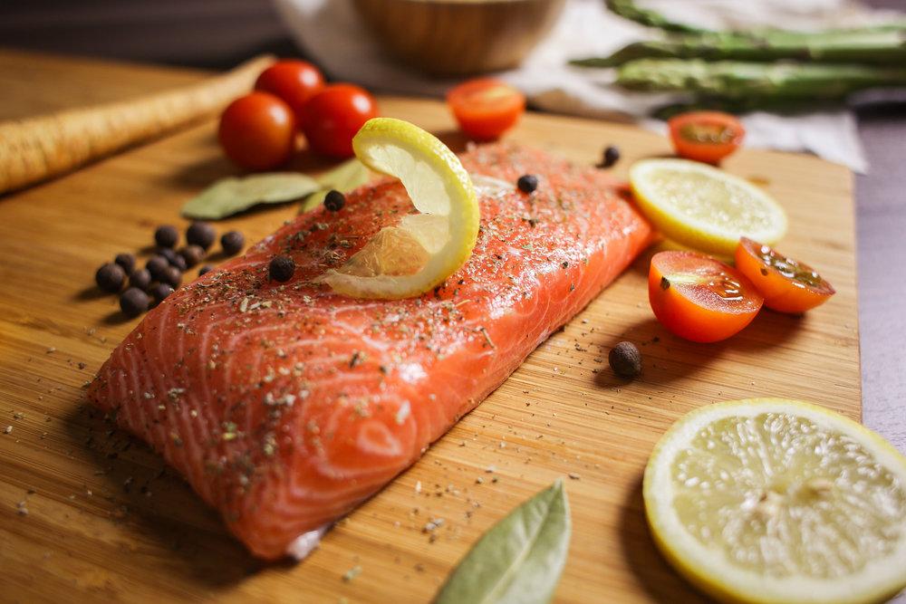 Why do we use lemon on seafood