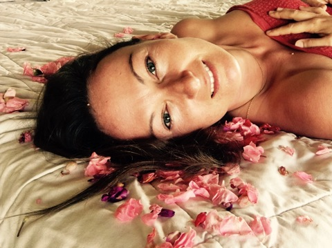 Christiane on bed with flowers.jpg