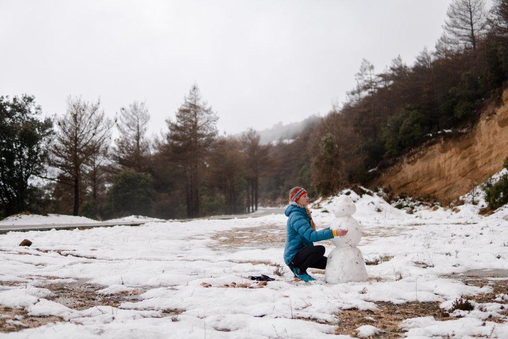 Leah building a snow man :)