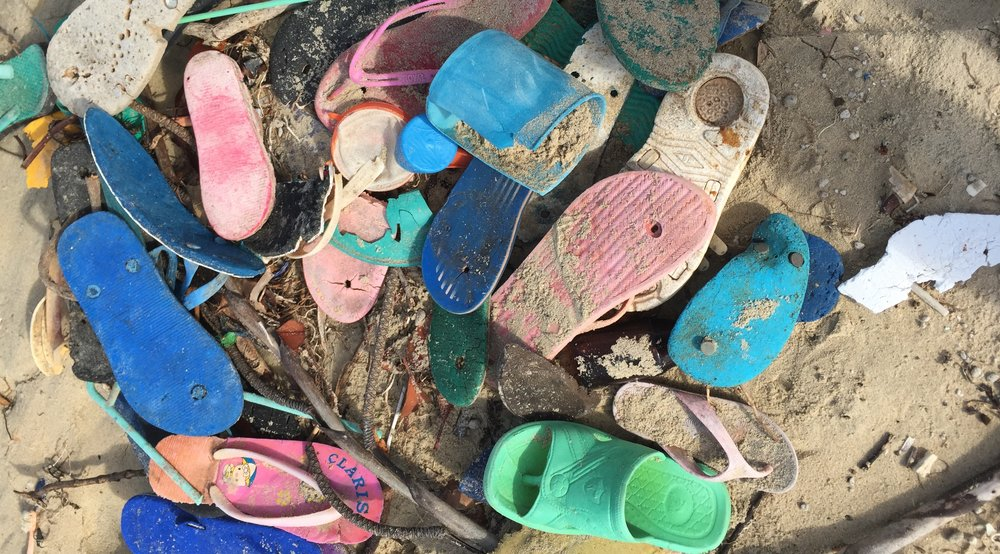 - THESE ARE SOME OF THE FLIPFLOPS THAT WERE FOUND ON THE BEACH