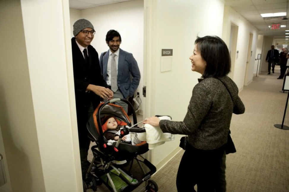 Del. Kathy Tran (D-Fairfax) chats with legislative assistants Rodrigo Velasquez, left, and Adi Radhakrishnan. (Timothy C. Wright for the Washington Post)