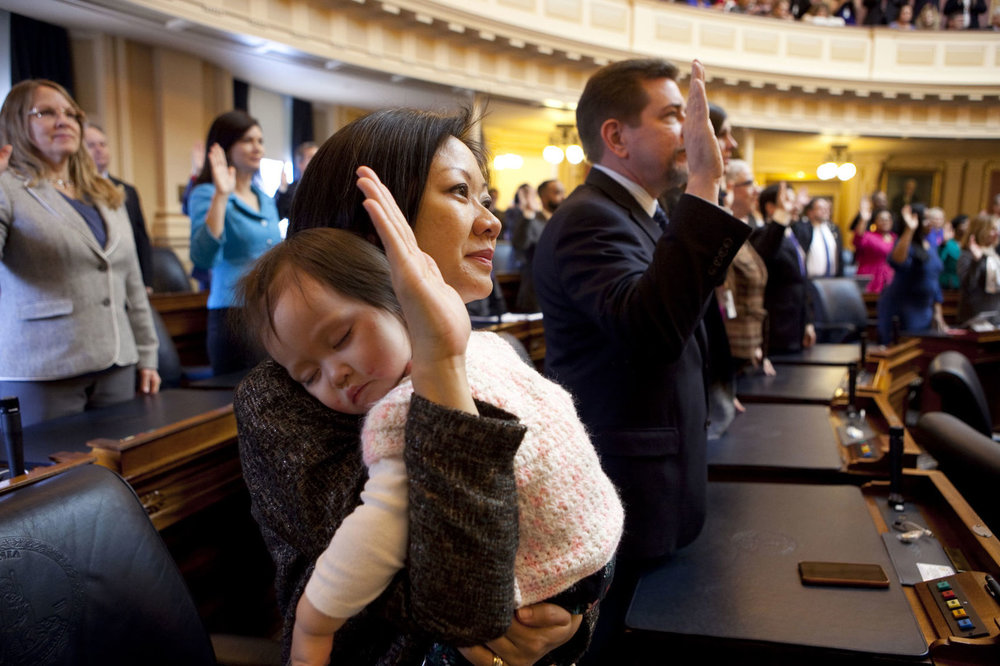 Del. Kathy Tran (D-Fairfax) holds daughter Elise during Tran's swearing-in ceremony at the Virginia General Assembly. (Timothy C. Wright/For The Washington Post)