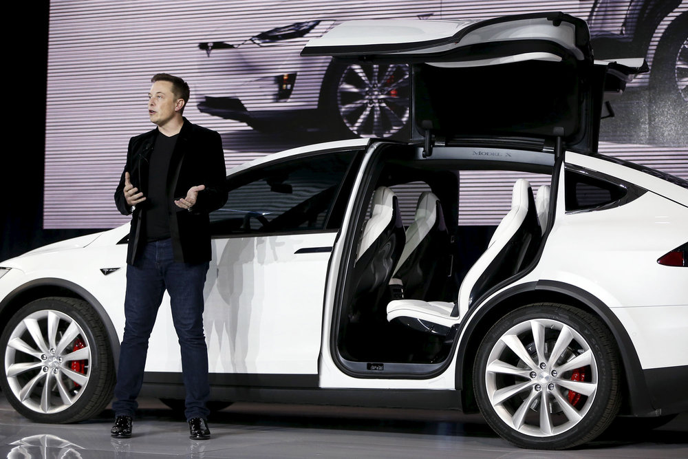 Tesla CEO unveiling the coveted Model X. Photo Credit: CNBC