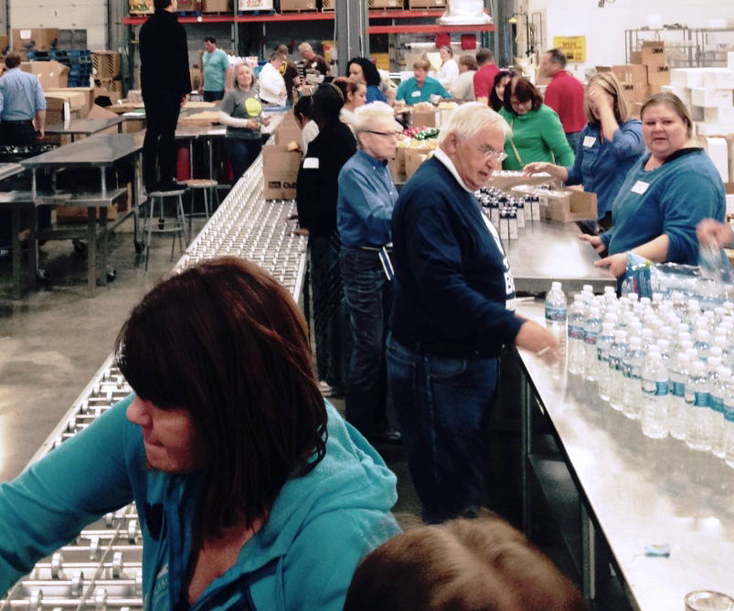 Blizzard Box Blitz  Event - DCMS employees work to pack meals for the eldery to be used during the winter months.