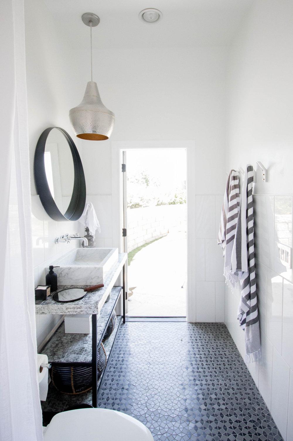 KOA HOUSE_pool bathroom gatsby tile white cb2 crescent mirror hammered silver pendant custom vanity silver leaf 2.jpg