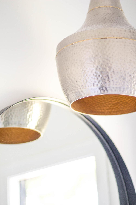KOA HOUSE_Hammered nickel brass pendant bathroom black round mirror cb2 crescent mirror Pool bath.jpg