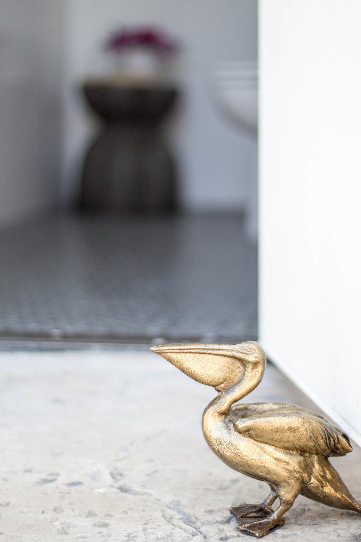 KOA HOUSE_pool bathroom black and white brass pelican doorstop cb2 tile shop gatsby_.jpg