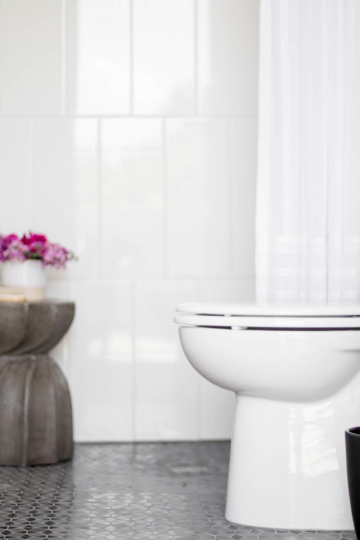 KOA HOUSE_pool bathroom gatsby tile black and white modern toilet cement side table shower.jpg