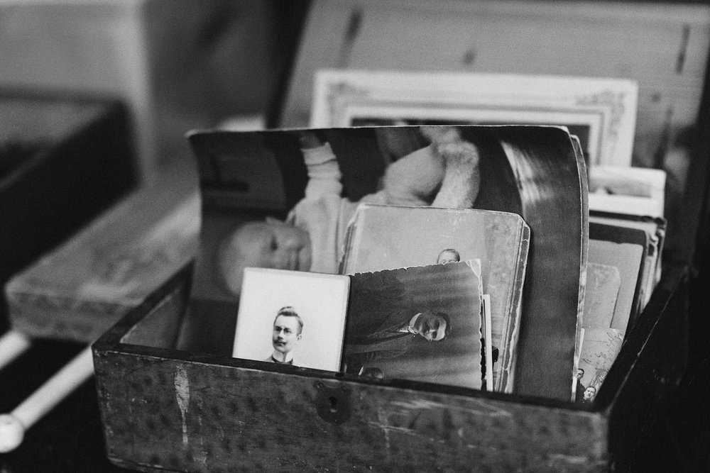 Box of loose photos b&w.jpg