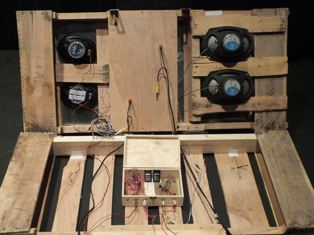 In order to have easy access to the circuit and speakers in case of damage, the two halves of the skid are connected with a pair of hinges, essentially creating a lid to allow for access to the circuits when needed.  Several slats were then removed from the inside of the palette to allow room for the speakers to be affixed directly underneath the sheet metal.