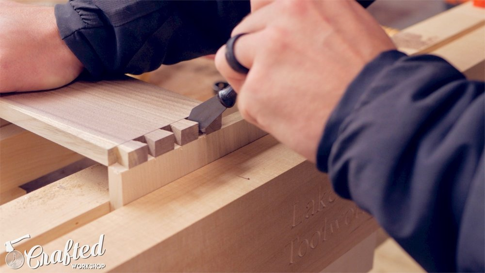 using a marking knife to transfer tails to pin board for hand cut dovetails woodworking