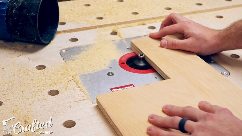 rounding over plywood edges using ⅜ inch radius roundover bit on woodpecker's router lift