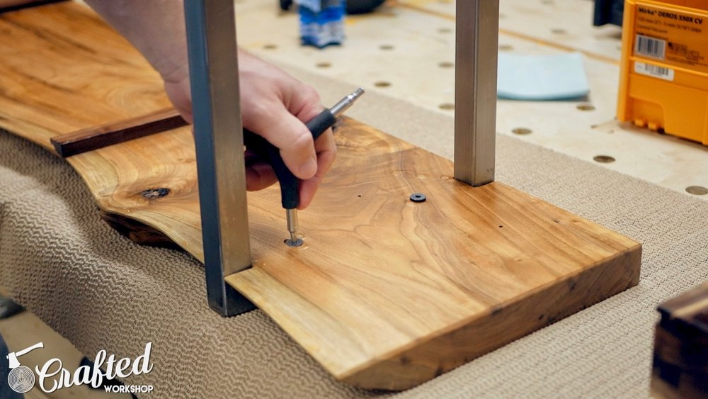 attaching metal leg to live edge slab waterfall coffee table