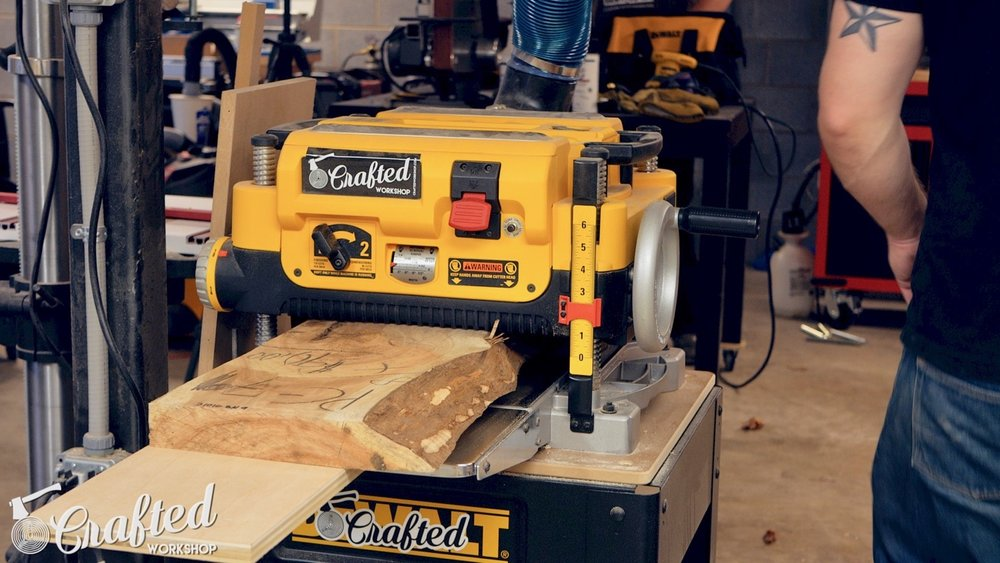 running live edge slab through planer on planer sled