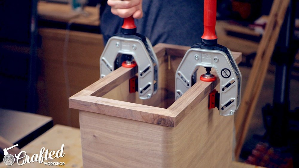 using bessey face frame clamps to attach Walnut face frame to cabinet