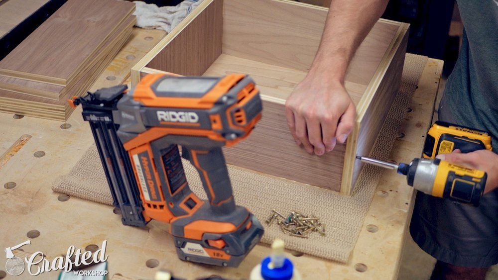 assembling plywood drawer using brad nails, glue, and screws