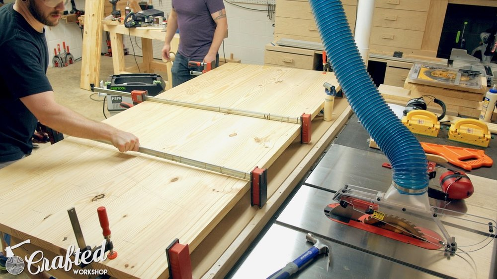 Gluing up the center panel of the table top.
