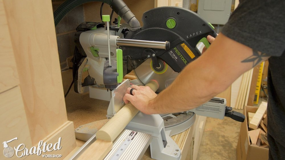 Cutting dowels to length on my Festool Kapex miter saw.