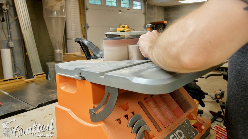 Rounding over the top end of the legs using my RIDGID Oscillating Belt Sander.