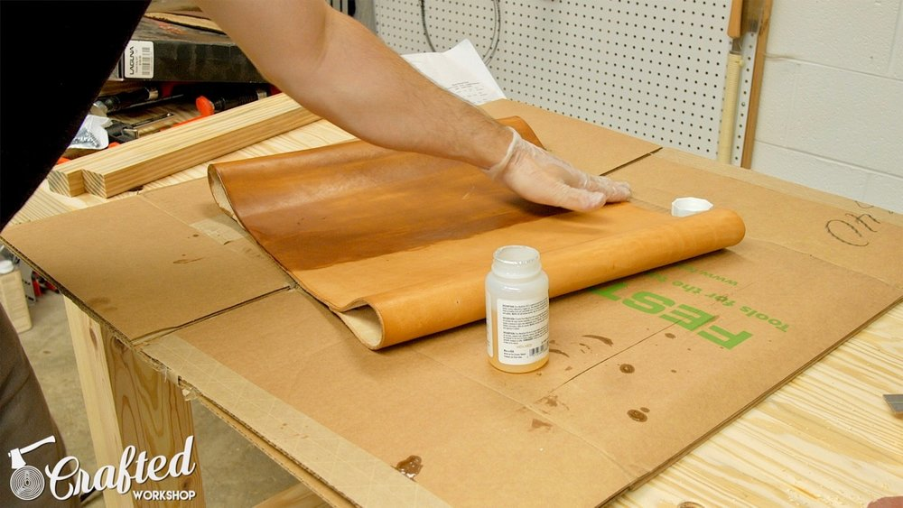 Applying Pure Neatsfoot Oil to vegetable tanned leather hide using my hands.