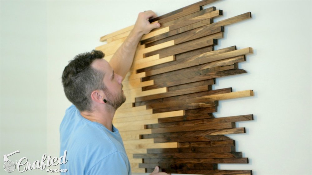 Hanging scrap wood wall art using metal French cleat hardware.
