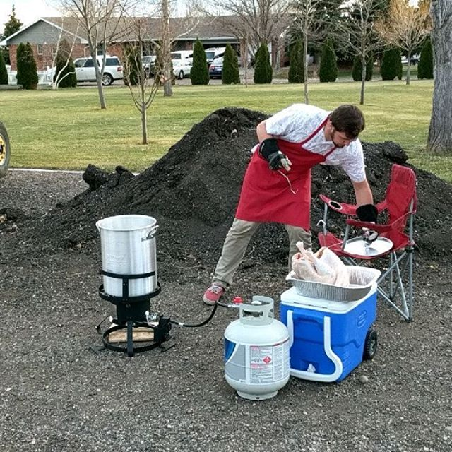 Zach, our sale's director deep frying a 15lb turkey for the Zenzen family on Thanksgiving