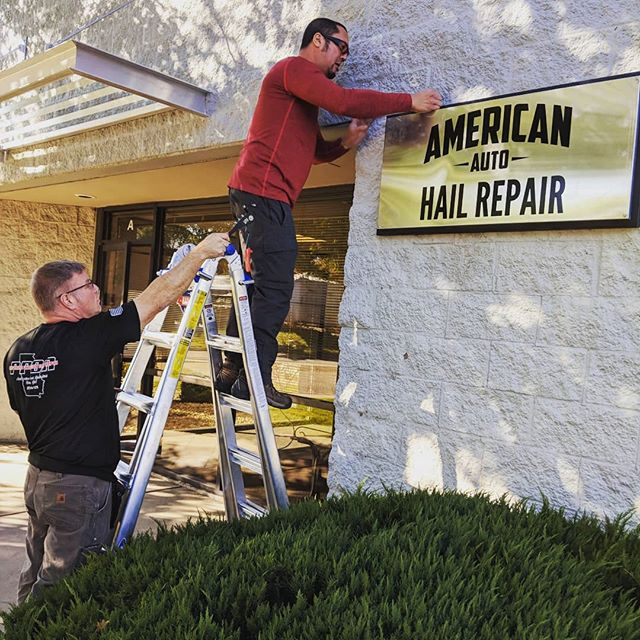 Phil putting our sign up on our new building! (Below) Scott lending a helping hand.  Come visit for a free estimate on your hail damaged vehicle! **Mention this post** for a $100 gift card to Amazon or Texas Roadhouse if we repair the vehicle  #hailrepair #denverhail #denvercolorado #denverbroncos #855hailyes  #303 #getsome #supportsmallbusiness #qualityoverquantity #aahail  AAhail.com  844-879-2247
