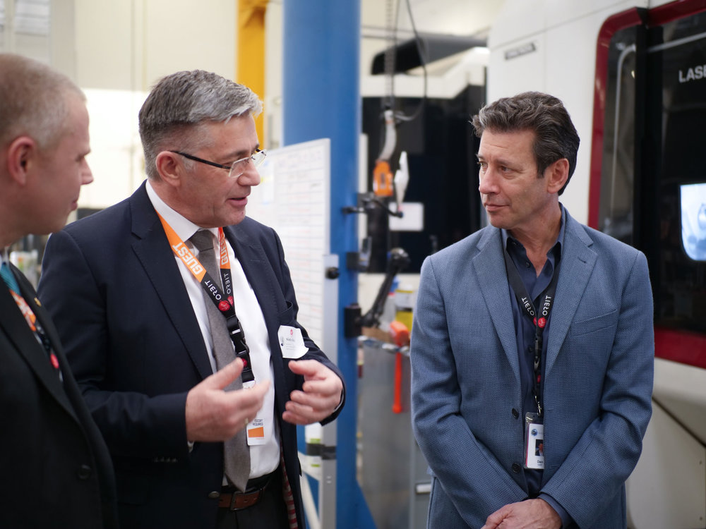 GomSpace CEO Niels Buus speaks with Virgin Orbit CEO Dan Hart during a tour of Virgin Orbit's rocket development and production facility in Long Beach, California. Credit: Virgin Orbit