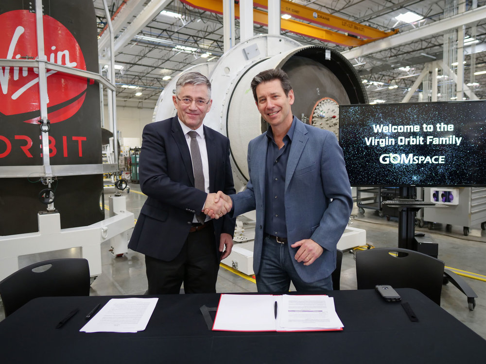 GomSpace CEO Niels Buus and Virgin Orbit CEO Dan Hart shake hands after signing a contract for the flight GomSpace's satellites on board Virgin Orbit's LauncherOne. Long Beach, California. Credit: Virgin Orbit