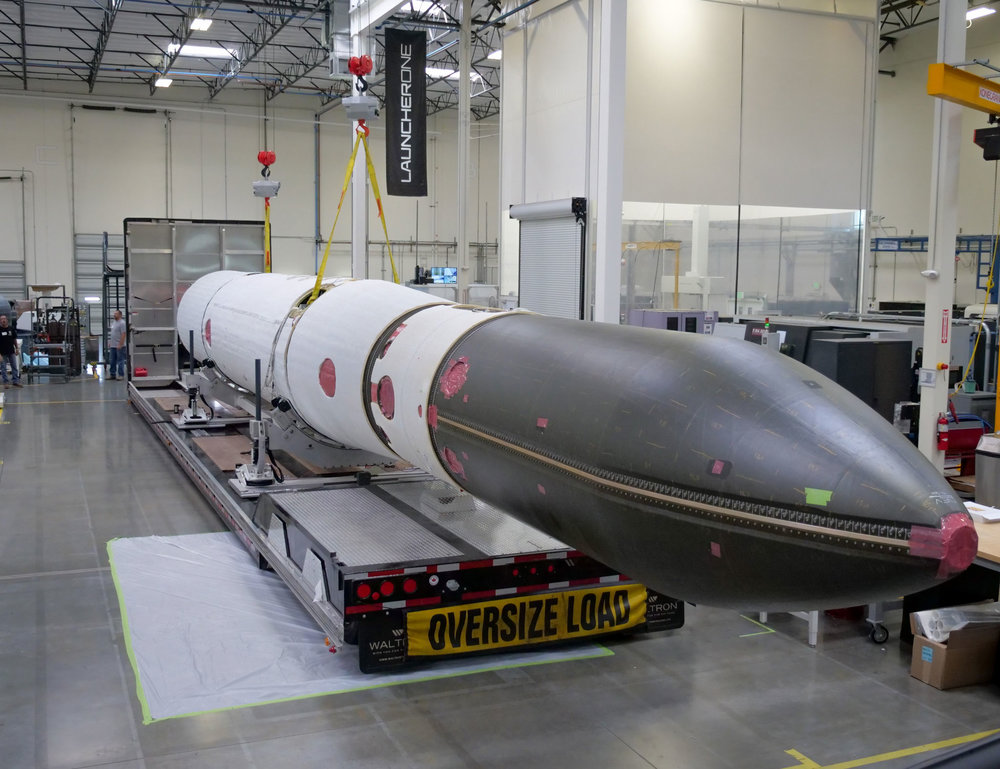 A fully-assembled LauncherOne rocket, shown here on the floor of Virgin Orbit's 180,000 square foot state-of-the-art manufacturing facility in Long Beach, California. This rocket will be used as part of the company's extensive ground testing campaign in advance of the LauncherOne's first flight to orbit.
