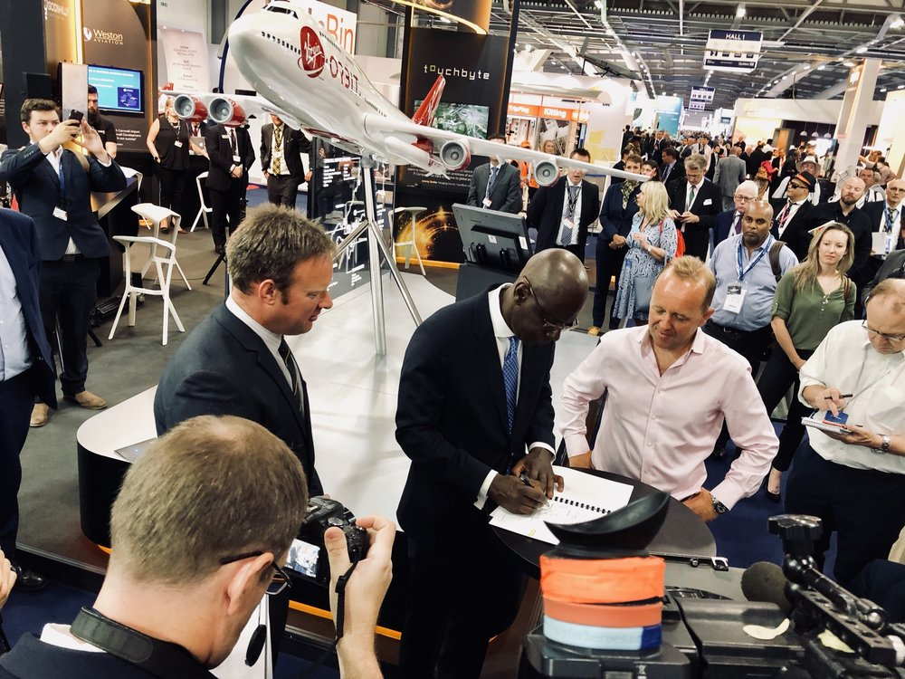 Virgin Orbit Chief Administrative Officer Derrick Boston signs the MOU at a press conference in Cornwall, UK. Photo: Virgin Orbit.