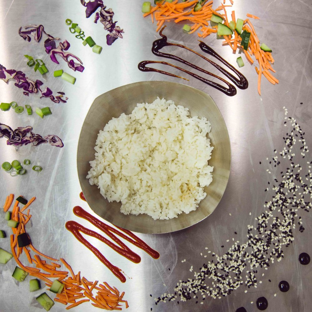stock-photo-cooked-rice-in-white-cup-301834046.jpg