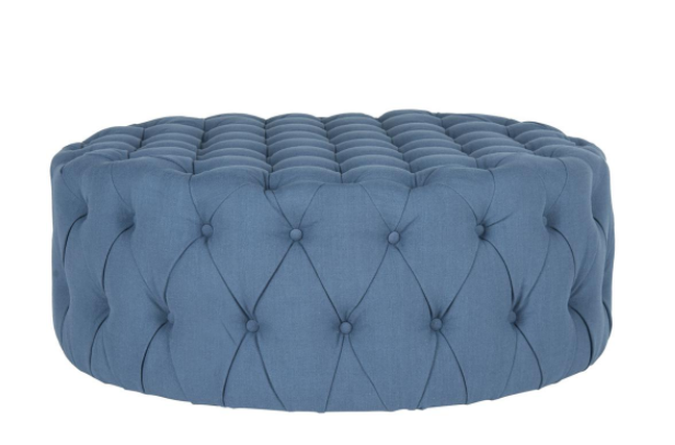 This classic tufted ottoman adds a pop-of color to our neutral family room.