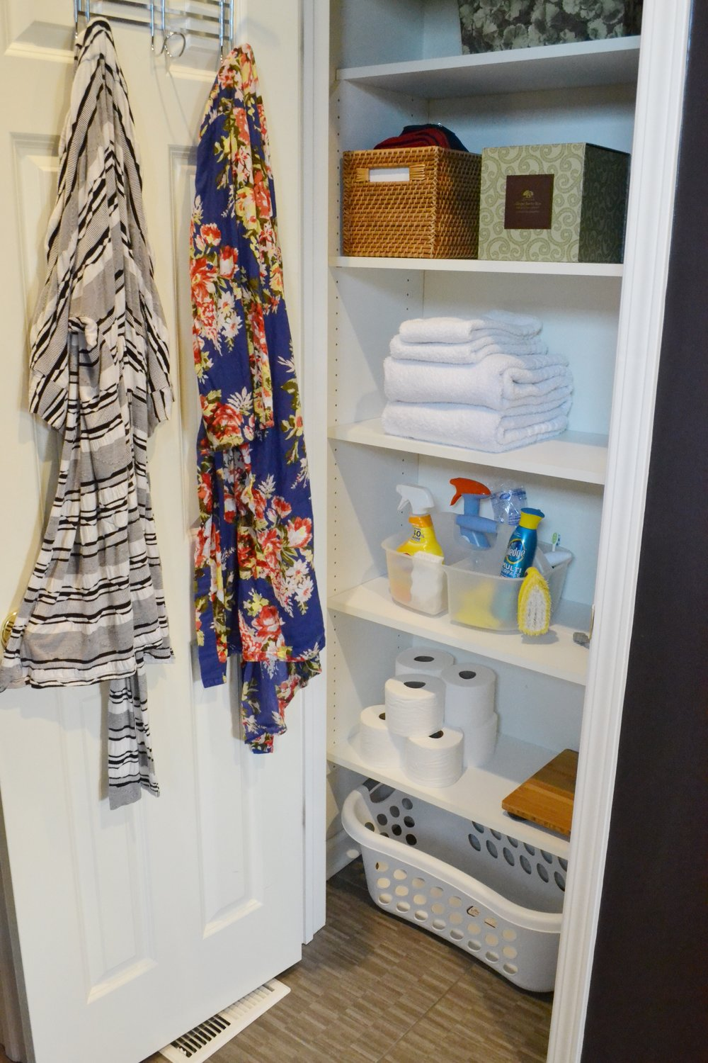 Linen Closet essentials - a limited supply of towels (and what you don't see is a spare set of sheets).