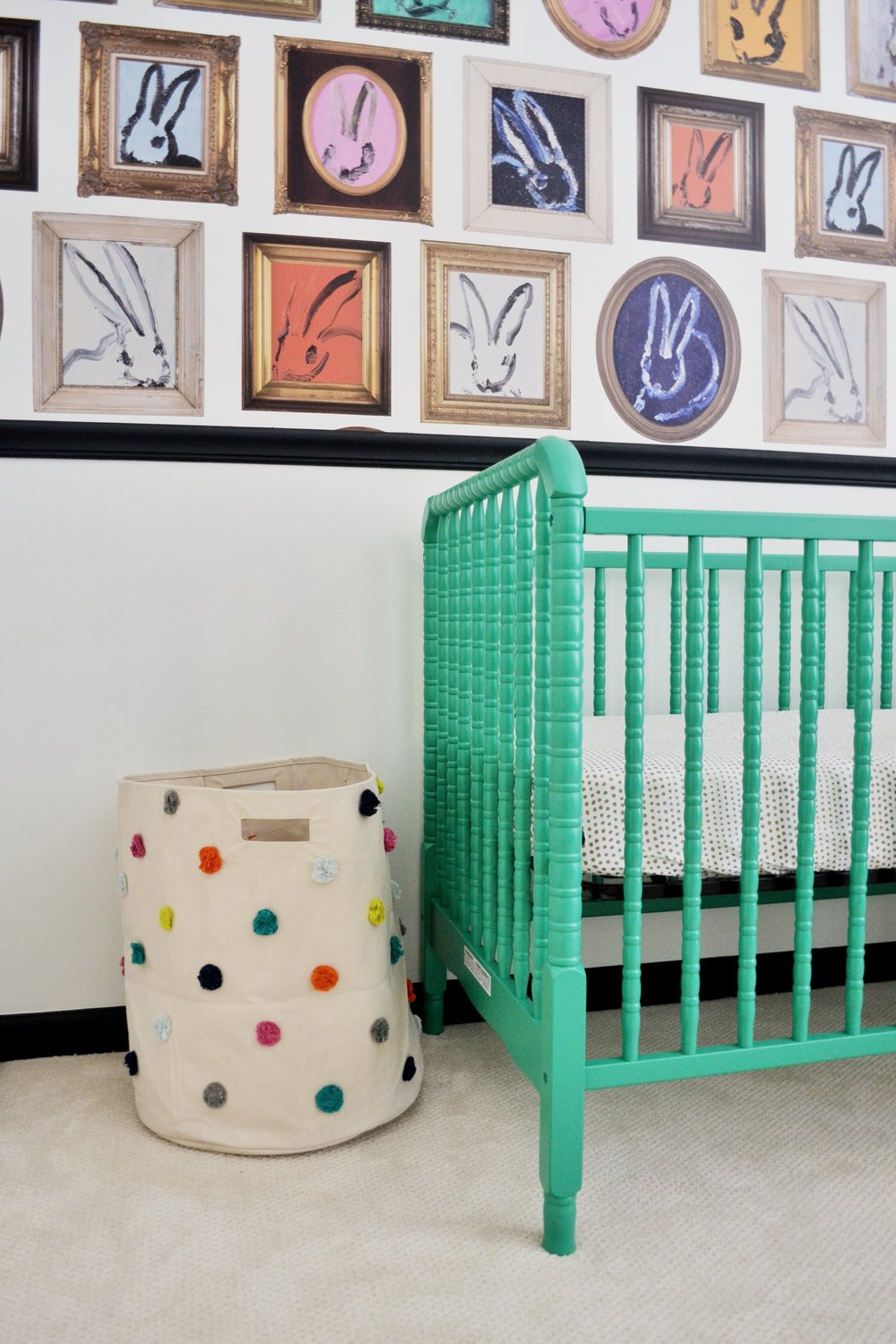 A not-so-neutral twin nursery featuring Hunt Slonem's Bunny Wallpaper.