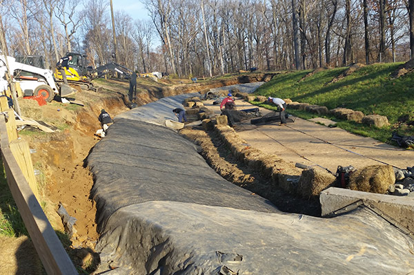 Installation of Geogrid reinforcement on PVC liner on existing stormwater basin – Chatham, NJ