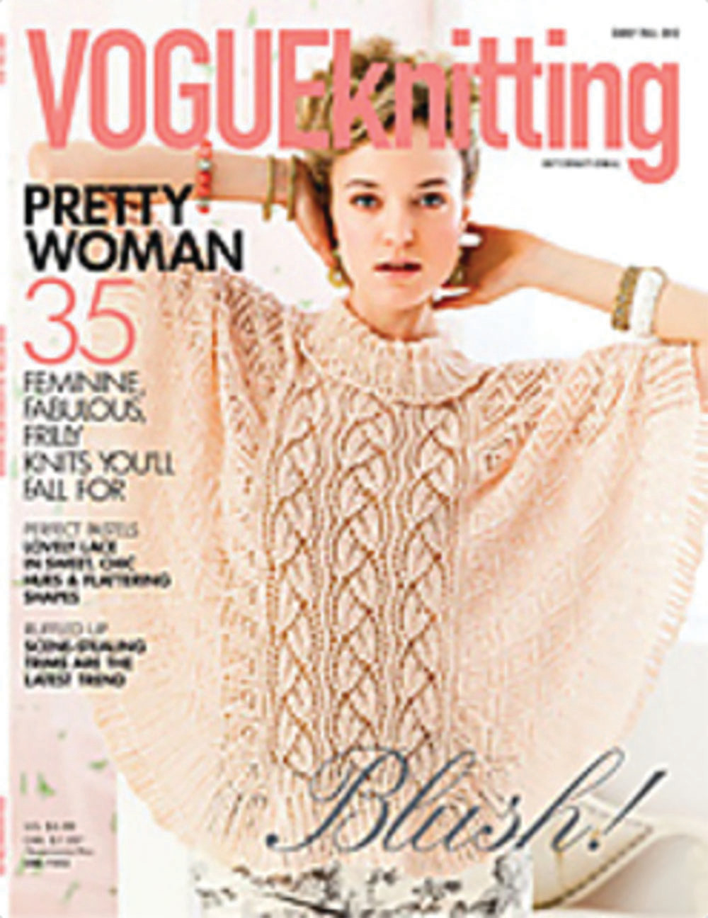 Lace Poncho - By: Lisa Daehlin   Knit in Koigu KPM  Vogue Knitting Early Fall 2012