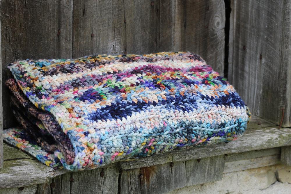 Moggie Blanket -By: Joanna Clayson - Crocheted in Koigu Othello1 skein of O340, O887, O180, O920, O950, O931, O309A, O930, O373, O482, O705, O918