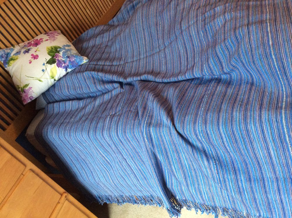 Stefanie - We picked up all of the yarn at the August barn sale. My dad (Ed Stefan) wove me this lovely king size coverlet from his own design . Using 43 skeins of KPM yarn and 1 spool of the off white on his Dorothy loom. He also took the time to twizzle all of the endsHe enjoys working with the yarn for weaving and for knitting.